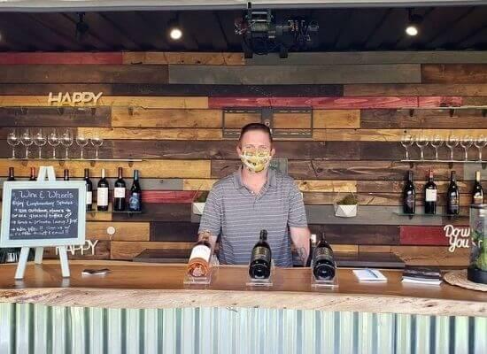 Charles McKahn serving McKahn Cellars' wines during happy hour at Feast It Forward